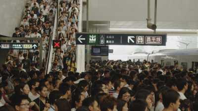 Foule dans le métro de Pékin