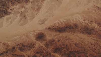 Formations rocheuses dans le sable, lever de soleil