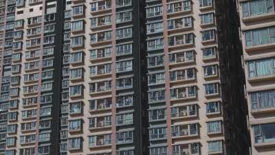 Immeubles roses et bleus à Kowloon