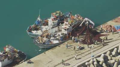 Petit port d'El Jebeha, pêcheurs, filet