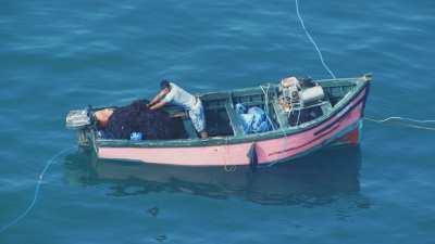 Petits bateaux de pêche à l'algue rouge